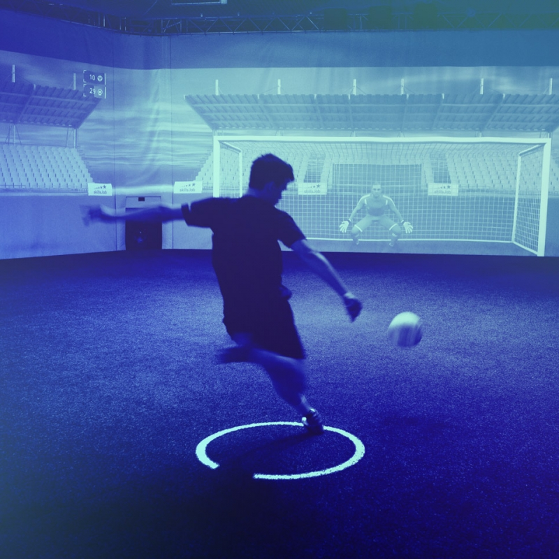 Image of an adult player shooting on the goal while training at skills.lab Arena