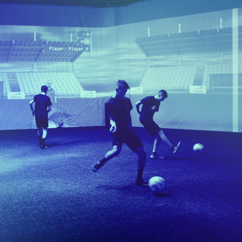 Three youth players in a parallel passing exercise during a free trial at skills.lab