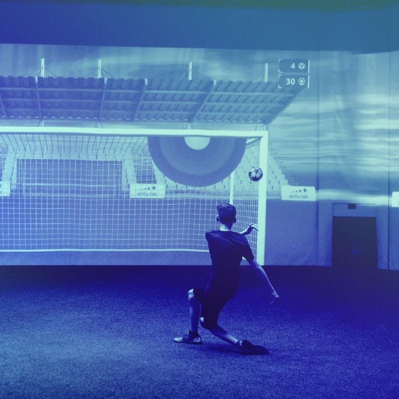 A youth player shooting towards the goal during an exklusive training at skills.lab
