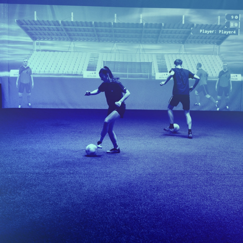 Image showing two adult players at skills.lab Arena in a parallel passing exercise