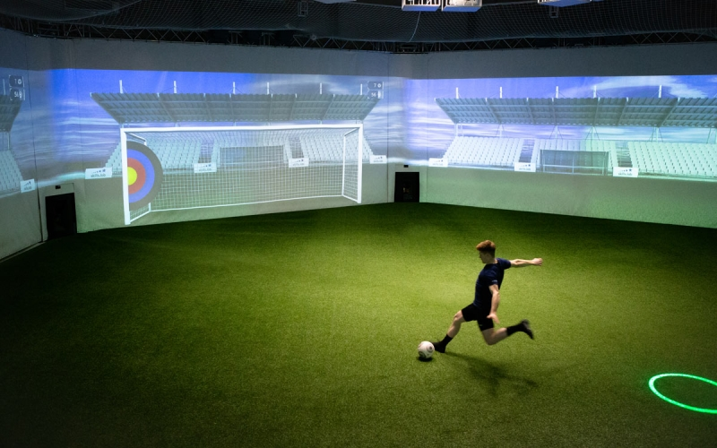 Image of an adult player shooting on a target during a training session at skills.lab Arena