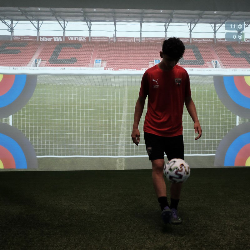 FC Ingolstadt - Image of a youth team player holding up a ball in the skills.lab Arena