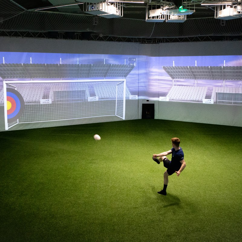 Skills Check - Image showing an adult player during a finishing exercise in the skills.lab Arena in Wundschuh